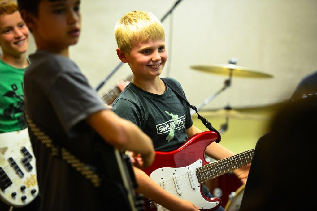 Boy Playing The Guitar | The Lesson Studio